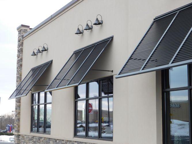 carroll-awning-company-inc-stone-wall-tavern-bahama-shutters-flat-metal-canopies2.jpg